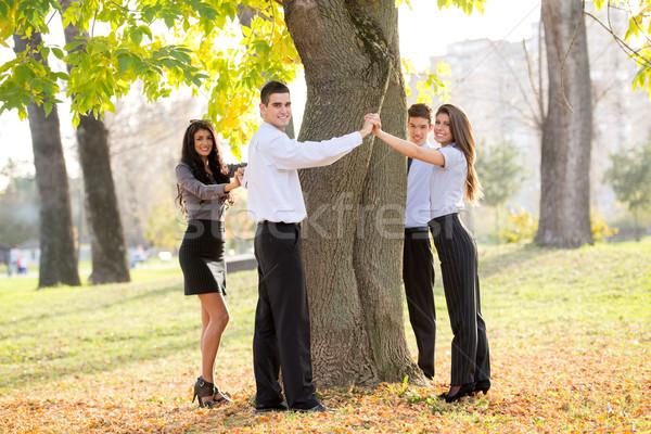 Mettre nature groupe jeunes gens d'affaires permanent Photo stock © MilanMarkovic78