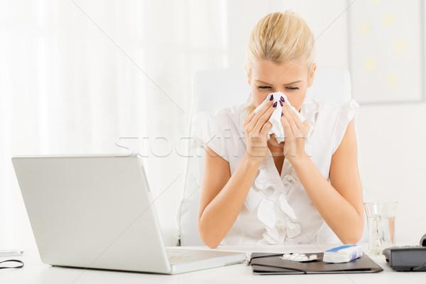 Griep jonge blond zakenvrouw werkplek Stockfoto © MilanMarkovic78