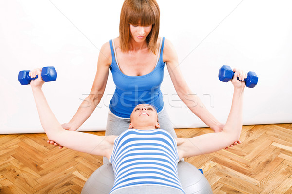 Exercising With a Personal Trainer Stock photo © MilanMarkovic78