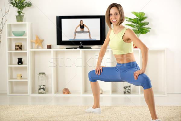Nő testmozgás tv fiatal nő sportok ruházat Stock fotó © MilanMarkovic78