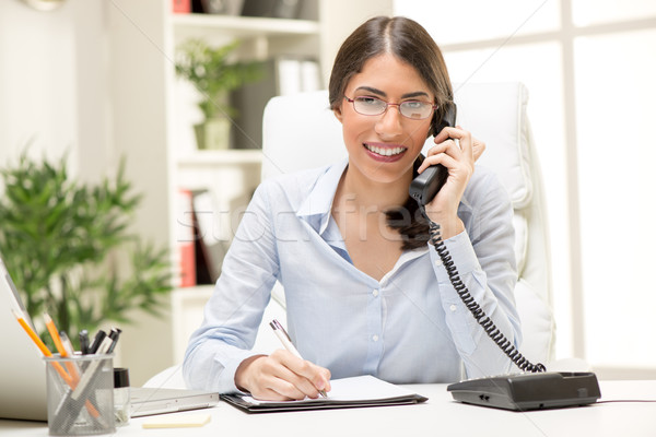 Beautiful Businesswoman Phoning In The Office Stock photo © MilanMarkovic78