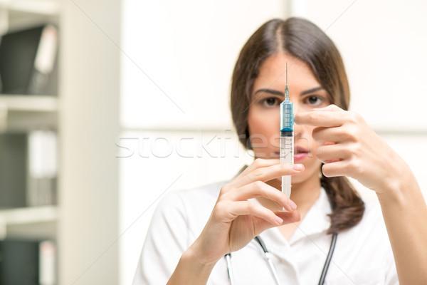 вакцинация довольно молодые медсестры инъекций анестезия Сток-фото © MilanMarkovic78