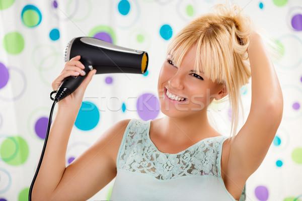 Girl Making Hairstyle Stock photo © MilanMarkovic78