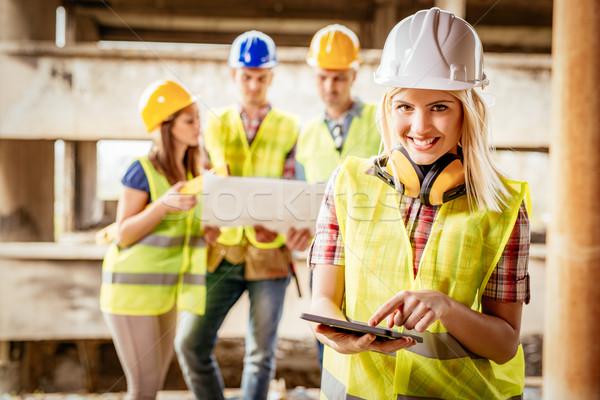 Reconstrução catástrofe belo jovem feminino construção Foto stock © MilanMarkovic78