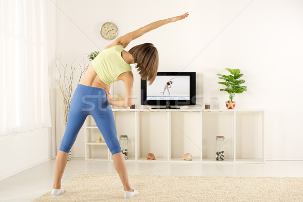Girl Exercise, Watching TV Stock photo © MilanMarkovic78