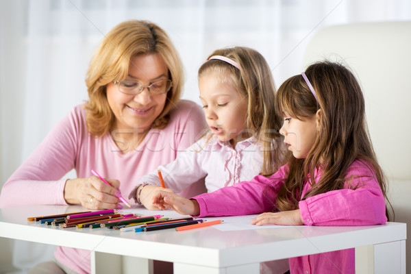 Cute little girls drawing Stock photo © MilanMarkovic78