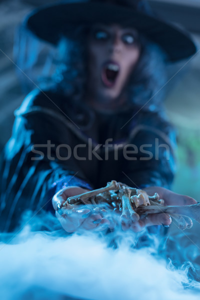 Stock photo: Bones In Witch's Hands