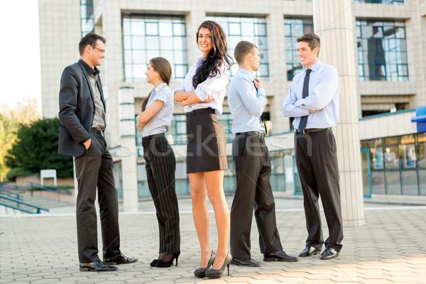 Fiatal üzleti csapat aranyos üzletasszony csapat üzletemberek Stock fotó © MilanMarkovic78
