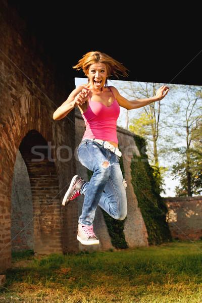 Happy woman jump Stock photo © MilanMarkovic78
