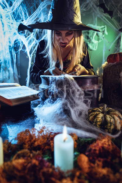Young Witch Is Cooking With Magic Bones Stock photo © MilanMarkovic78