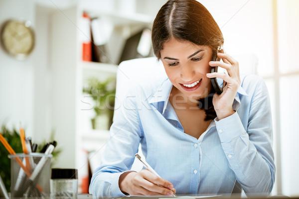 Sempre falar negócio bem sucedido mulher jovem trabalhando Foto stock © MilanMarkovic78