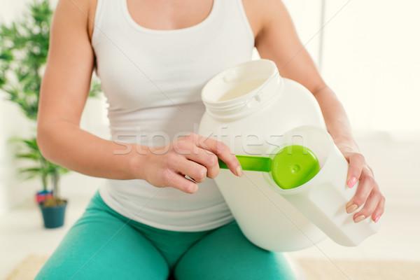 Elvesz fehérje kiegészítők közelkép fitnessz nő áramló Stock fotó © MilanMarkovic78