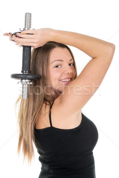 Triceps jeune femme exercice haltères énergie Photo stock © MilanMarkovic78