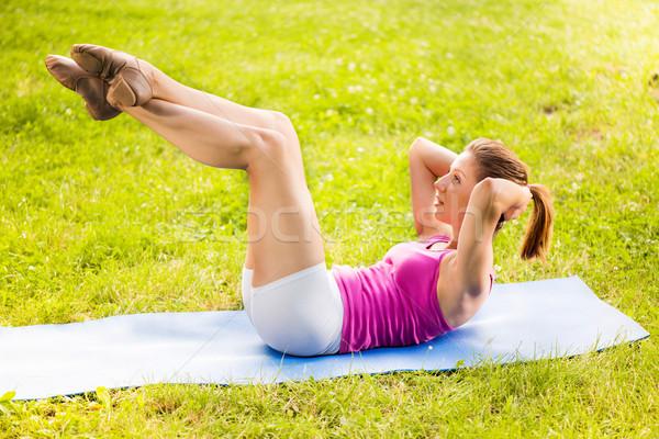 Exercising Sit-ups Stock photo © MilanMarkovic78
