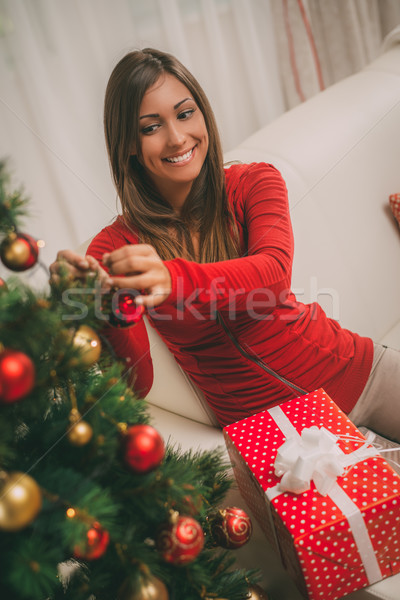 Girl Decorating Christmas Tree Stock photo © MilanMarkovic78