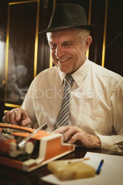 ретро старший человека писателя Hat улыбаясь Сток-фото © MilanMarkovic78