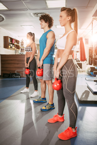 Three Friends Exercising At The Gym Stock photo © MilanMarkovic78