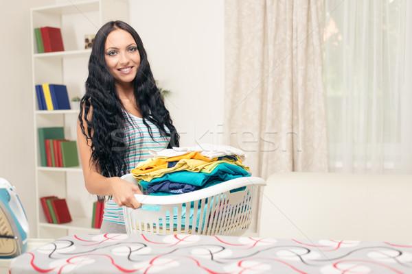 Strijken jonge mooie vrouw permanente mand wasserij Stockfoto © MilanMarkovic78