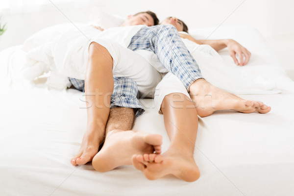 Intertwined Legs Sleeping Couple Stock photo © MilanMarkovic78
