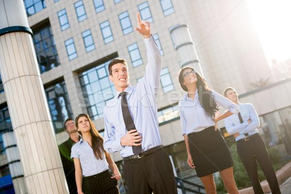 Górę młodych biznesmen biurowiec palce strony Zdjęcia stock © MilanMarkovic78