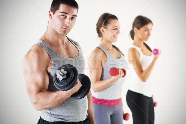 Gruppe Menschen Heben Gewichte Bizeps Ausübung Stock foto © MilanMarkovic78