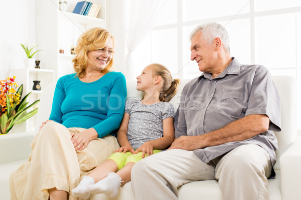 Grandparents with little girl Stock photo © MilanMarkovic78