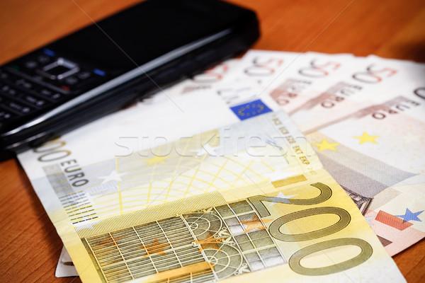 Megtakarítás mobiltelefon sok Euro pénz pénzügy Stock fotó © MilanMarkovic78