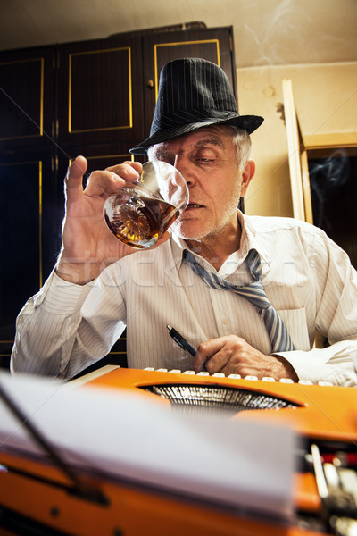 Retro Senior Man Writer With A Glass Of Whiskey Stock photo © MilanMarkovic78