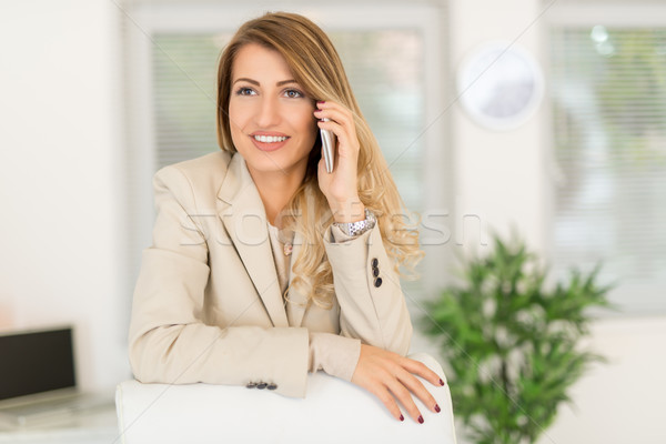 Businesswoman Phoning In Office Stock photo © MilanMarkovic78