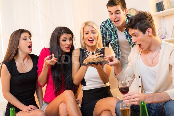 Születésnapi buli kis csoport fiatalok ül kanapé derűs Stock fotó © MilanMarkovic78