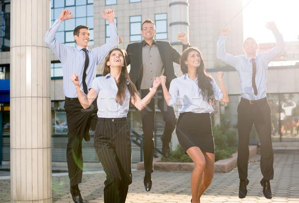 Działalności skok grupy młodych ludzi biznesu skoki Zdjęcia stock © MilanMarkovic78