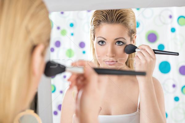 Gyönyörű nő jelentkezik bőrpír közelkép gyönyörű lány kék szemek Stock fotó © MilanMarkovic78