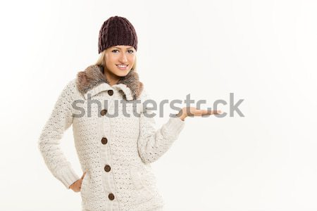 Blonde Girl In Winter Clothes, With Outstretched Palm Stock photo © MilanMarkovic78