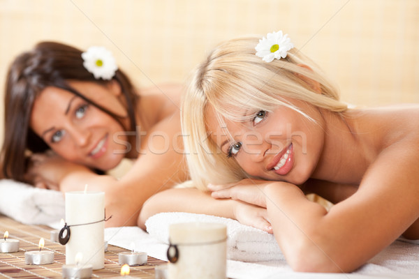 Two young women relaxing at the spa center Stock photo © MilanMarkovic78