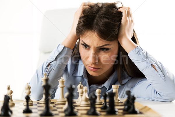 Young Worried Businesswoman In Front Of The Chessboard Stock photo © MilanMarkovic78