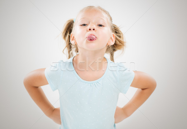 Little girl sticking her tongue out Stock photo © MilanMarkovic78