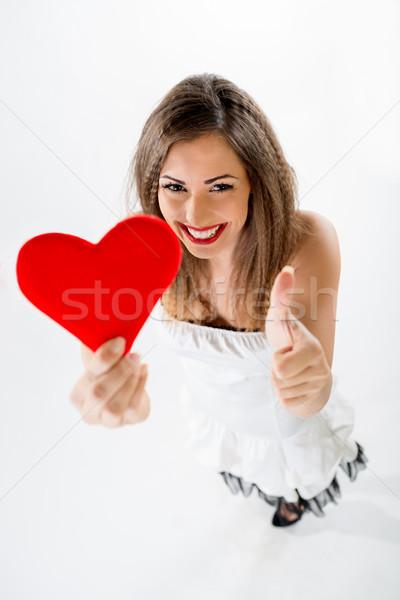 Schönen lächelnd Mädchen halten Stock foto © MilanMarkovic78