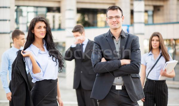 Jeunes femme d'affaires affaires équipe permanent Photo stock © MilanMarkovic78