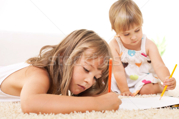 Little girls drawing Stock photo © MilanMarkovic78