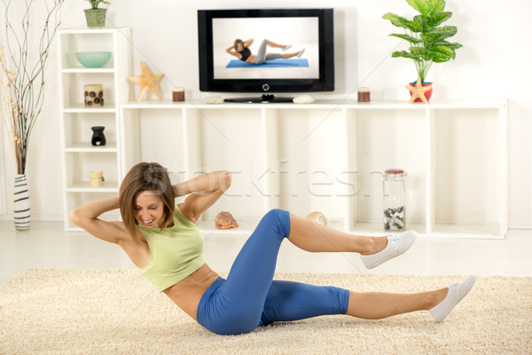 Testmozgás otthon fiatal nő sportok ruházat szoba Stock fotó © MilanMarkovic78