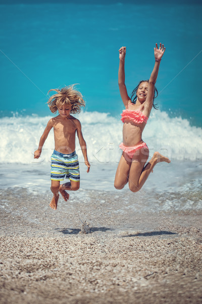 Kids Fun On The Beach Stock photo © MilanMarkovic78