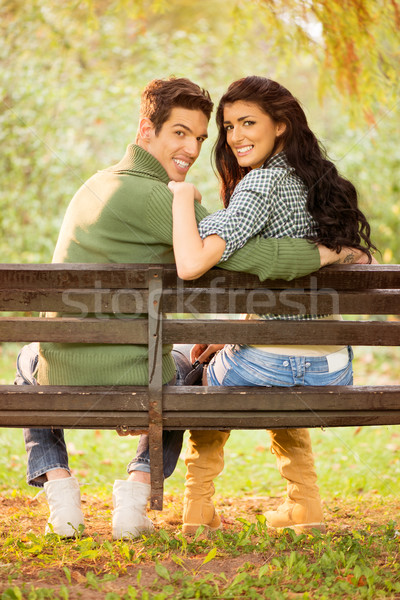 молодые улыбаясь пару парка скамейке фото Сток-фото © MilanMarkovic78