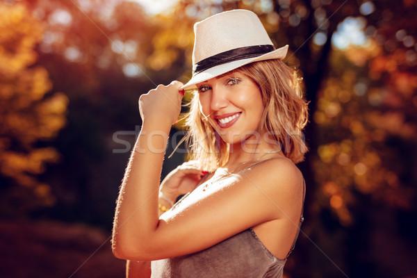 美少女 帽子 肖像 美しい 笑みを浮かべて 若い女性 ストックフォト © MilanMarkovic78