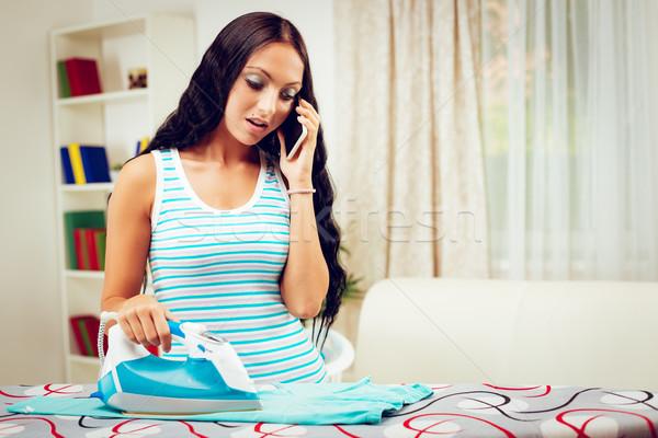 Housewife Ironing And Using Phone Stock photo © MilanMarkovic78