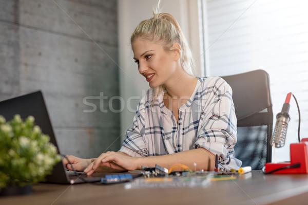 Woman Testing Circuit Board In Her Office Stock photo © MilanMarkovic78