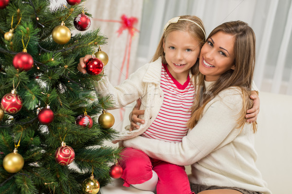 Mother And Dughter Decorating Christmas Tree Stock photo © MilanMarkovic78