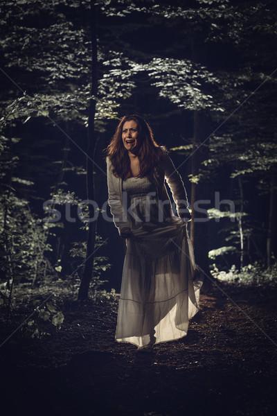 Korku genç korkmuş kadın yürüyüş orman Stok fotoğraf © MilanMarkovic78