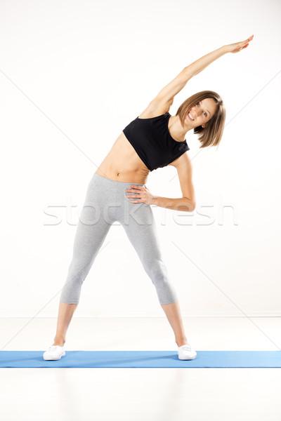 Fiatal nő testmozgás sportok ruházat sportos épít Stock fotó © MilanMarkovic78