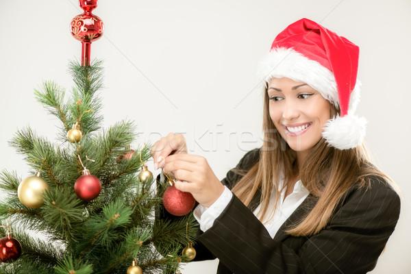 üzletasszony karácsonyfa gyönyörű fiatal visel mikulás Stock fotó © MilanMarkovic78