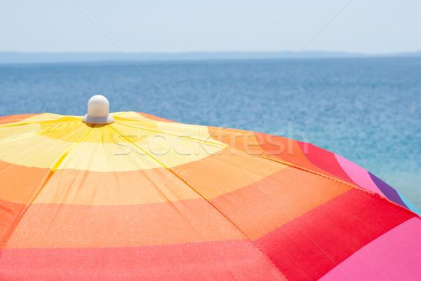 Guarda-sol guarda-sol mar praia céu Foto stock © MilanMarkovic78